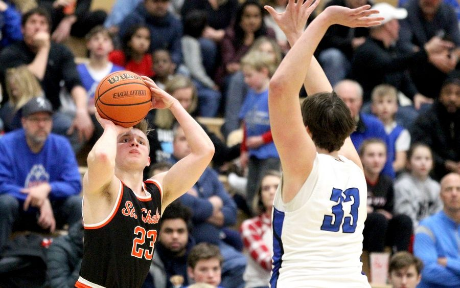 St. Charles East's Scott Breidigan (23) shoots three points during a game at St. Charles North on Feb. 14.