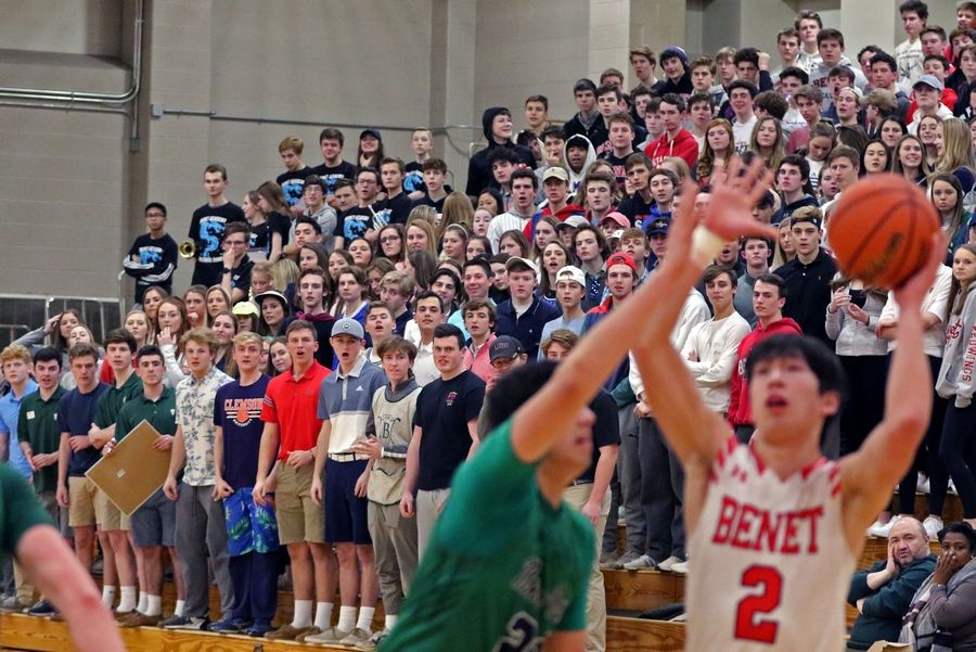 The Benet student section watches a game against visiting Notre Dame on Feb. 14. The Redwings won 45-43.