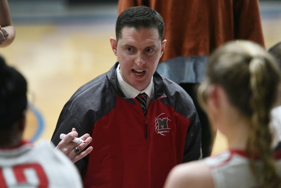 Mundelein's coach Greg Dorgan talks to the team after the first quarter during Monday's Class 4A regional girls basketball game against Wheeling in Lake Zurich.