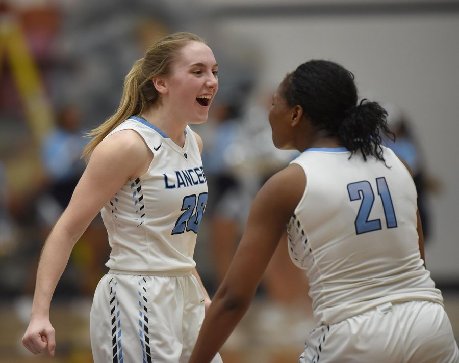 Lake Park's Emma Thorne and Darrione Rogers celebrate their win against Barlett in the Class 4A Lake Park girls basketball regional final game in Roselle Thursday.