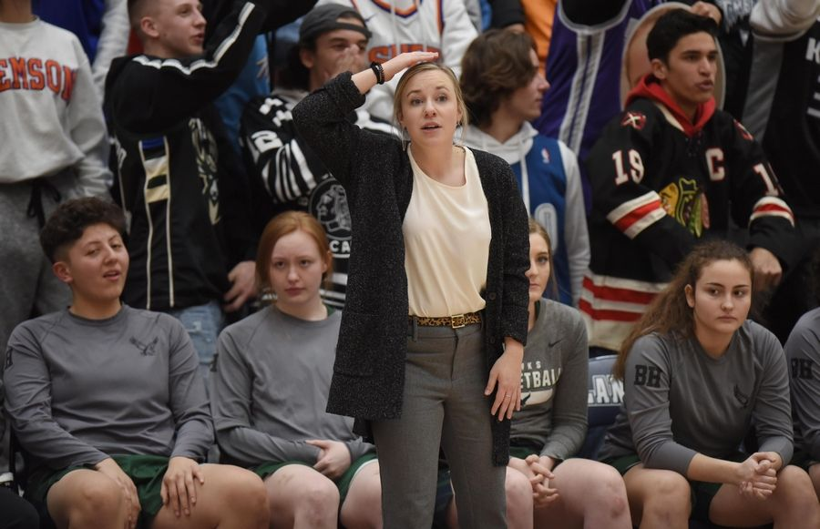 Bartlett head coach Kristi Ragan directs her team against Lake Park in the Class 4A Lake Park girls basketball regional final game in Roselle Thursday.