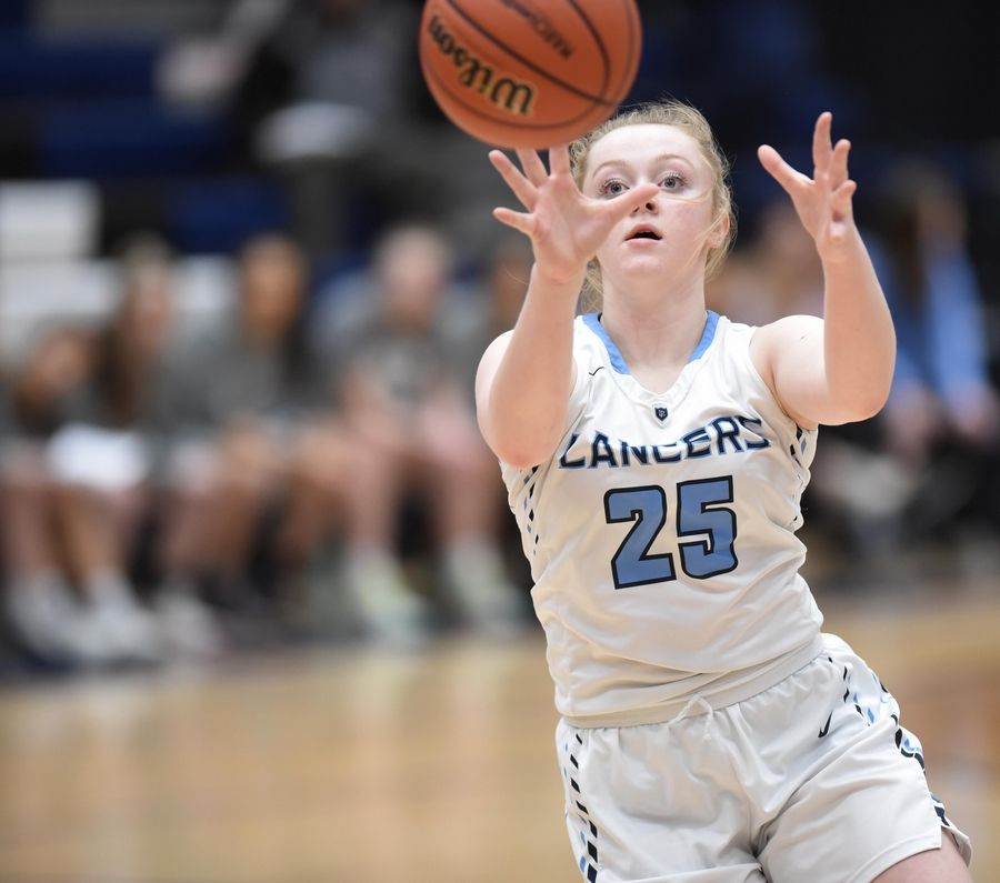 Lake Park's Ellie Helm takes a pass against Barlett in the Class 4A Lake Park girls basketball regional final game in Roselle Thursday.