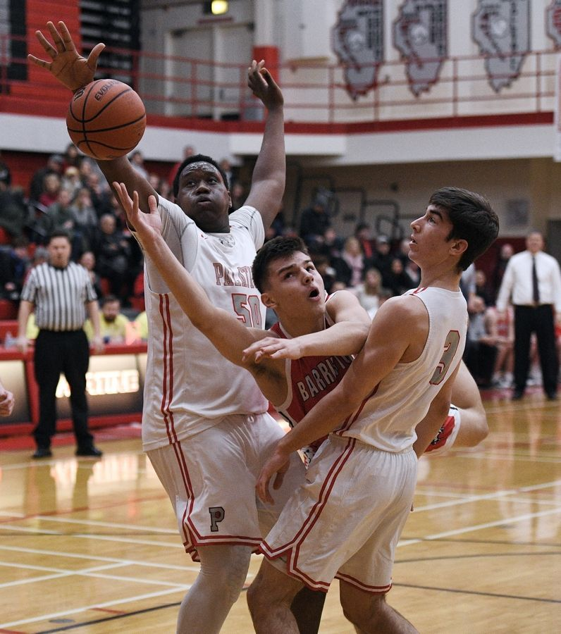 Palatine's Julian Campbell, left, attempts to block a shot by Barrington's Damian Zivak last week.