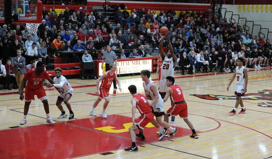 Schaumburg's Chris Hodges shoots a foul shot as a packed house watches the action in the varsity basketball matchup at Schaumburg on Friday.