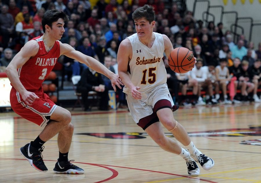 Mark Welsh/mwelsh@dailyherald.comSchaumburg's Jared Schoo looks for an opening against Palatine's Tommy Swanson in the varsity basketball matchup at Schaumburg on Friday.