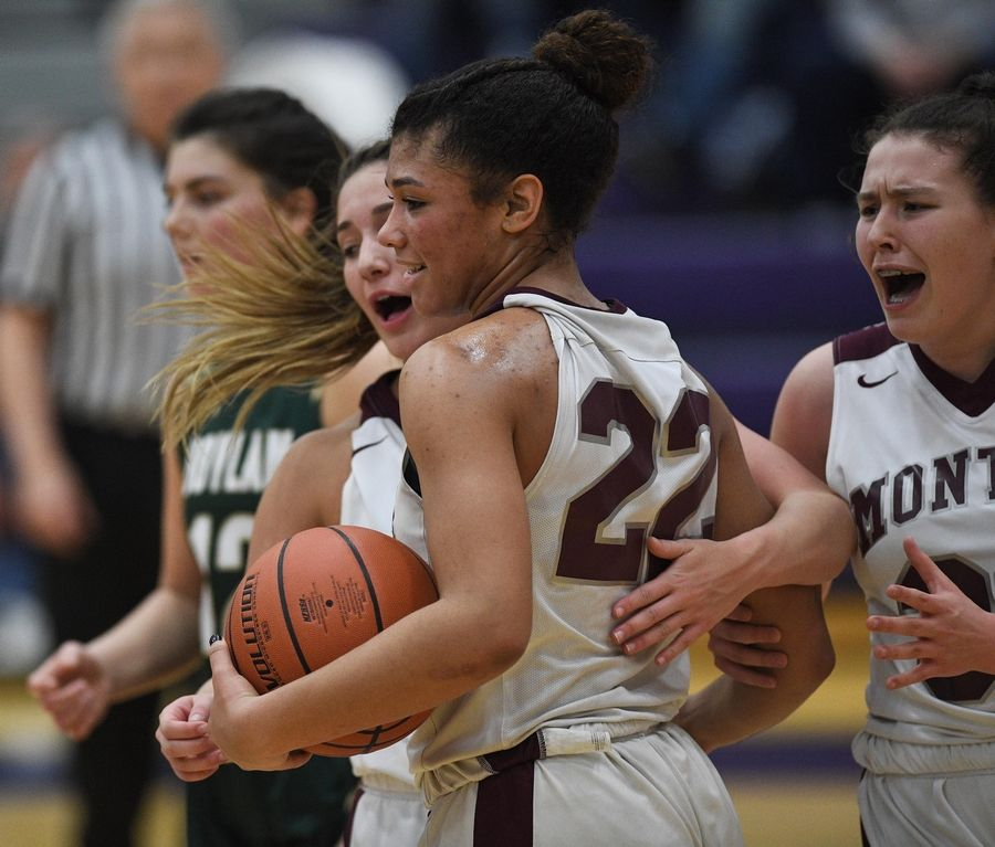 Montini's Tatiana Thomas holds the ball as teammates Angelina Giordano and Madisyn Saracco react late in the victory against Rockford Boylan in the Class 3A Hampshire girls basketball sectional semifinal game Tuesday.