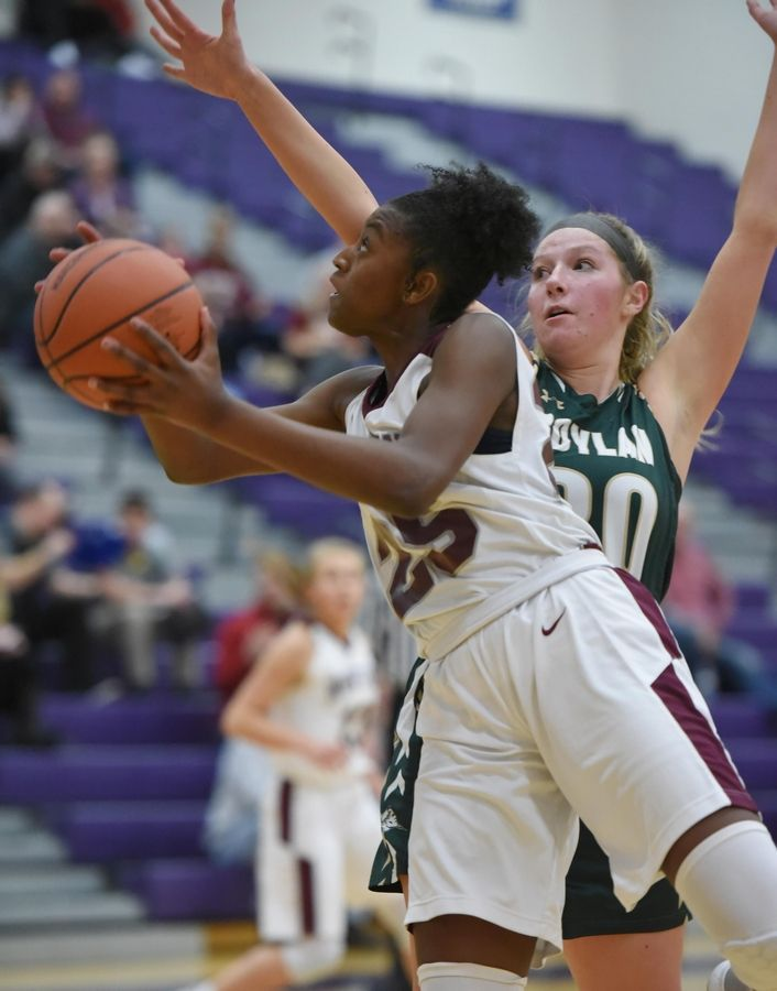 Montini's Taris Thornton shoots around Rockford Boylan's Hayley Sciortino in the Class 3A Hampshire girls basketball sectional semifinal game Tuesday.