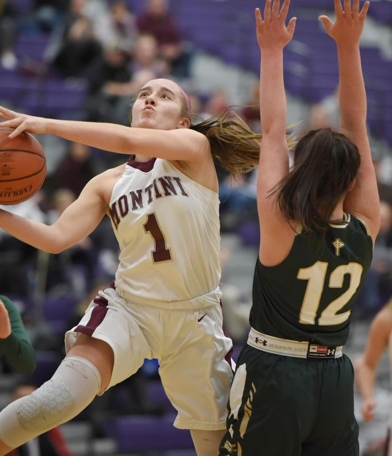 Montini's Sophie Sullivan scores around Rockford Boylan's Elle Eshelman in the Class 3A Hampshire girls basketball sectional semifinal game Tuesday.
