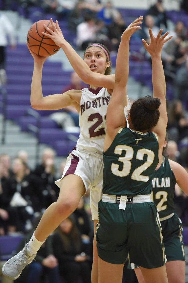 Montini's Taylor Charles scores around Rockford Boylan's Peyton Kennedy in the Class 3A Hampshire girls basketball sectional semifinal game Tuesday.