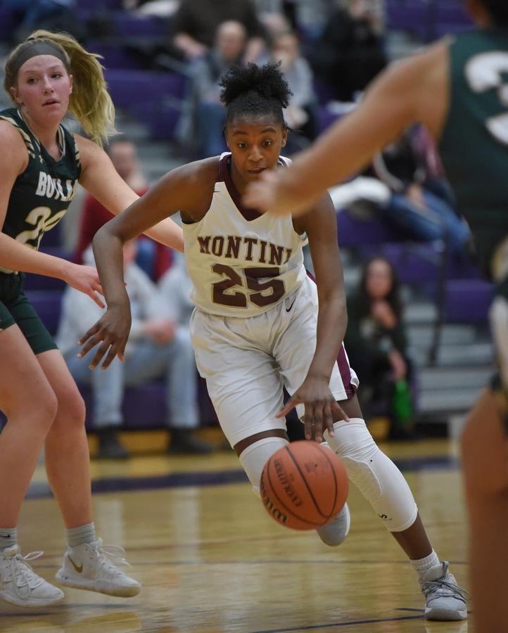 Montini's Taris Thornton drives into the Rockford Boylan defense in the Class 3A Hampshire girls basketball sectional semifinal game Tuesday.
