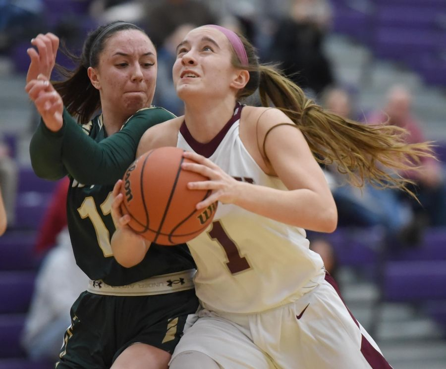 Montini's Sophie Sullivan collides with Rockford Boylan's Avery Marcomb in the Class 3A Hampshire girls basketball sectional semifinal game Tuesday.