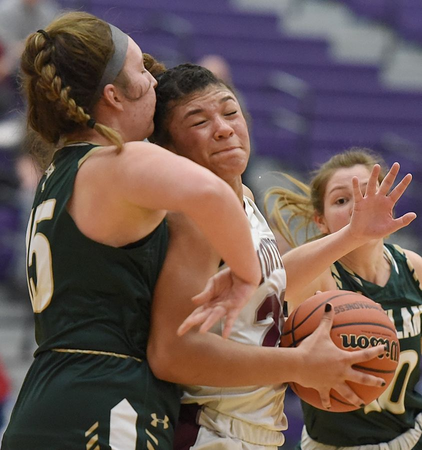 Montini's \Tatiana Thomas pushes into Rockford Boylan's Reagan Ulrich in the Class 3A Hampshire girls basketball sectional semifinal game Tuesday.