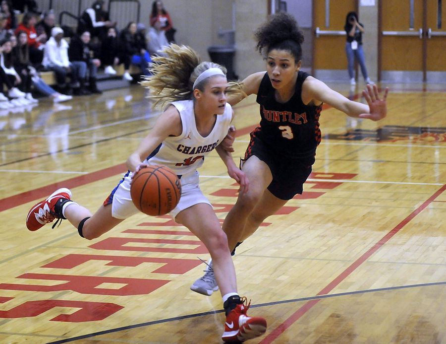 Dundee-Crown's Katelyn Skibinski drives to the basket against Huntley's Carley Faulkner in the first quarter of a the IHSA Class 4A Sectional semifinal girls basketball game between Dundee-Crown and Huntley Tuesday evening, Feb. 25, 2020, at Huntley High School.