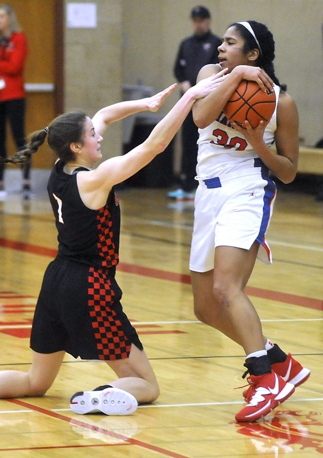 Huntley's Sydney Novak fouls Dundee-Crown's Alyssa Crenshaw in the fourth quarter of a the IHSA Class 4A Sectional semifinal girls basketball game between Dundee-Crown and Huntley Tuesday evening, Feb. 25, 2020, at Huntley High School.