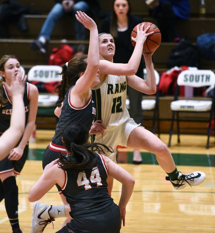 Grayslake Central's Amanda Kocialkowski (12) goes for a shot under heavy Deerfield pressure during Tuesday's Class 3A sectional semifinal girls basketball game at Crystal Lake South High School.