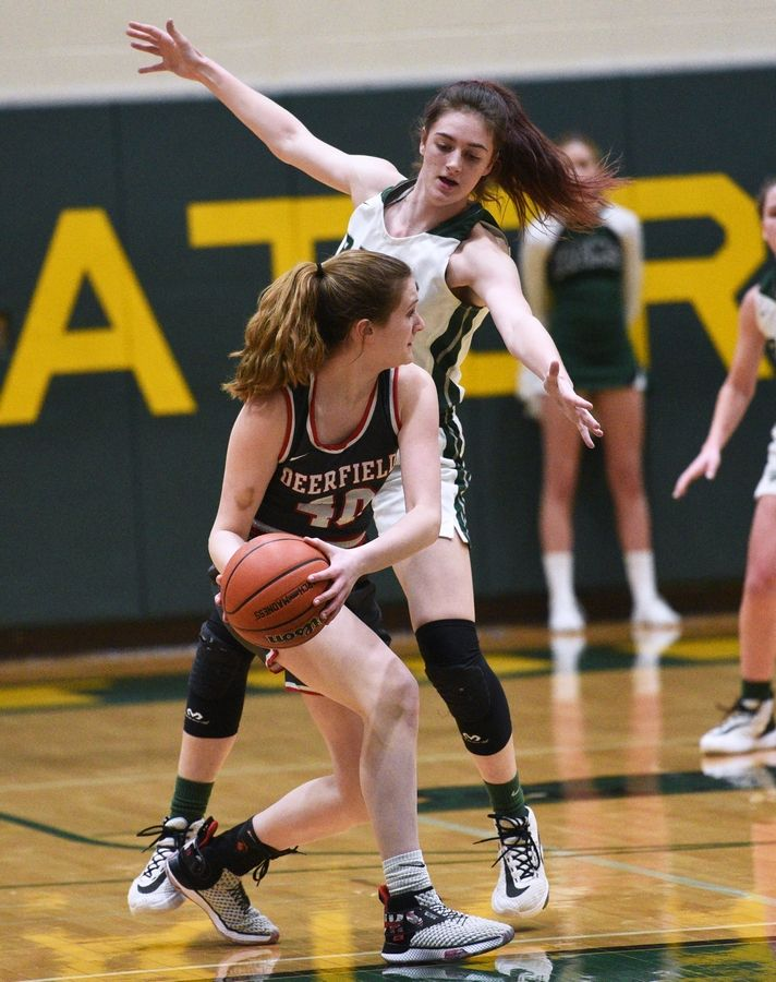 Grayslake Central's Kate Bullman towers over Deerfield's Morgan Kerndt (40) during Tuesday's Class 3A sectional semifinal girls basketball game at Crystal Lake South High School.