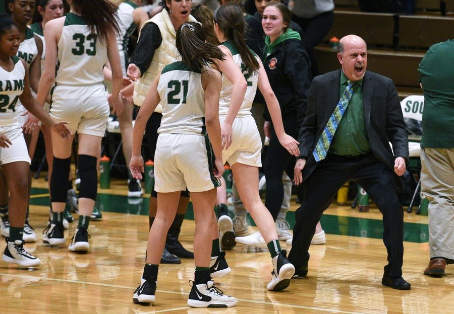 Grayslake Central head coach Steve Ikenn gets fired up over the Rams' second-period performance over Deerfield during Tuesday's Class 3A sectional semifinal girls basketball game at Crystal Lake South High School.
