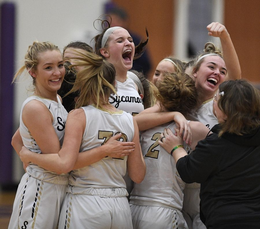 Sycamore celebrates their win against Burlington Central in the Class 3A Hampshire girls basketball sectional semifinal game Tuesday.