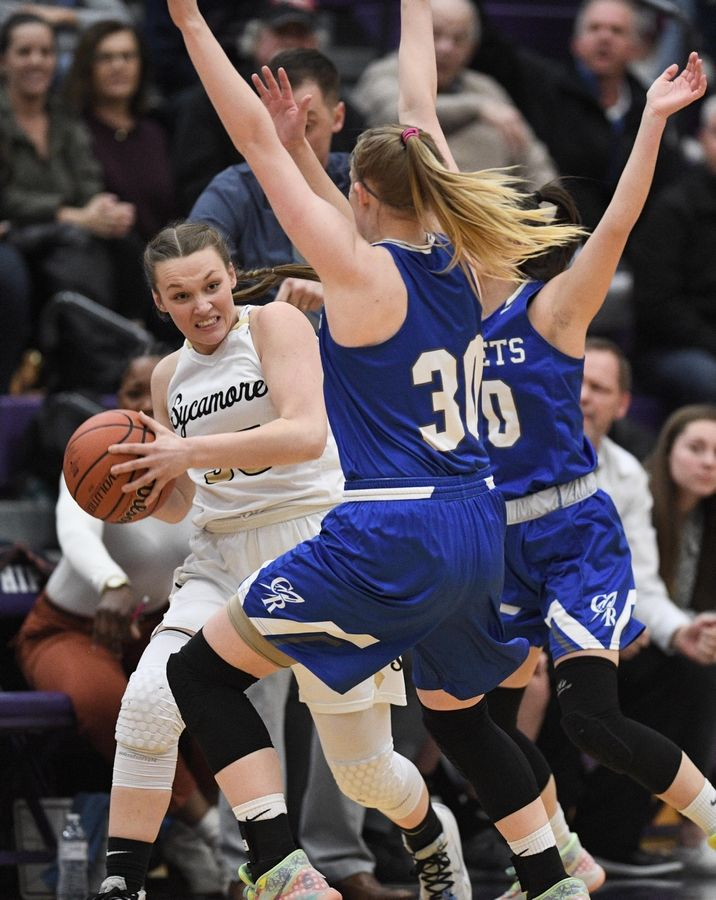 Burlington Central's Lily Moretti and Kat Schmidt (30) trap Sycamore's Ella Shipley in the Hampshire sectional Tuesday.