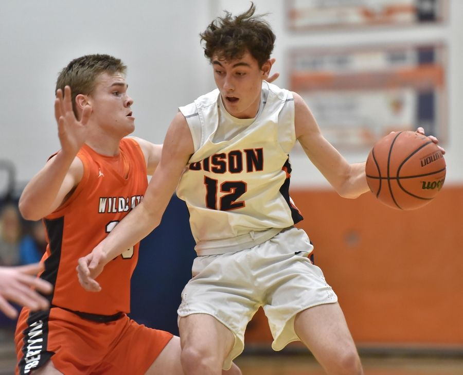 Buffalo Grove's Kam Craft, right, handles the ball against Libertyville earlier this season. BG travels to Schaumburg Wednesday night to play for the Mid-Suburban League championship.