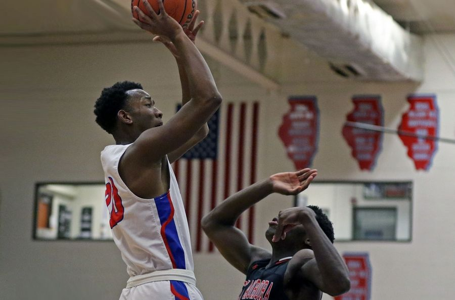 Glenbard South's Tajuan McKinnie takes a shot against East Aurora during a game in Glen Ellyn on Feb. 26. The Raiders won 60-56.