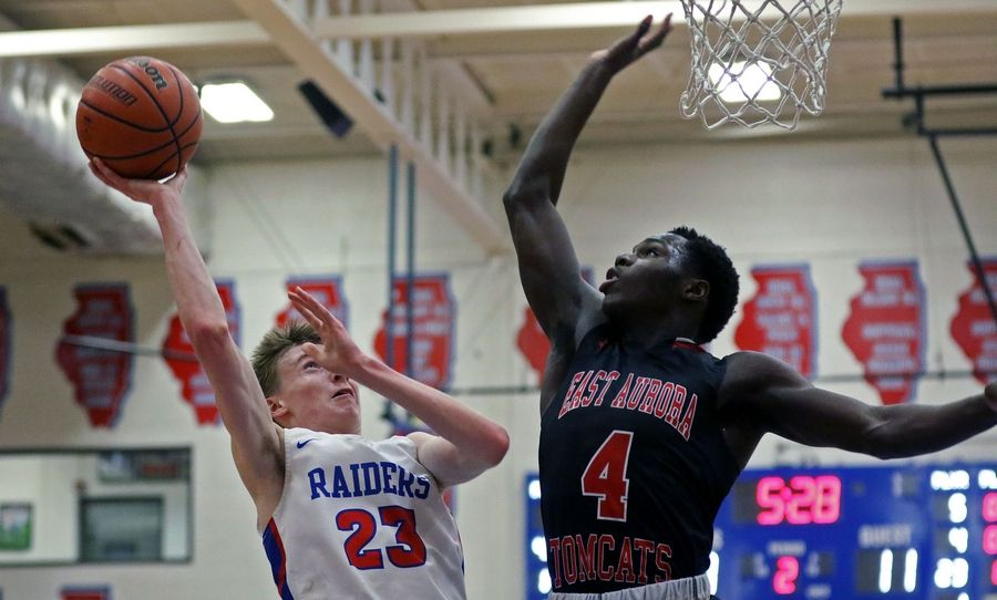 Glenbard South's Aryton Temcio takes a shot against East Aurora during a game in Glen Ellyn on Feb. 26. The Raiders won 60-56.