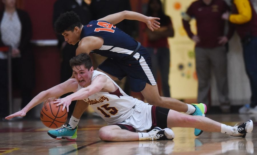 Schaumburg's Jared Schoo, front, gets to a loose ball ahead of Buffalo Grove's Steph Harris during the Mid-Suburban League championship game in Schaumburg Wednesday. Schaumburg defeated Buffalo Grove 49-43.