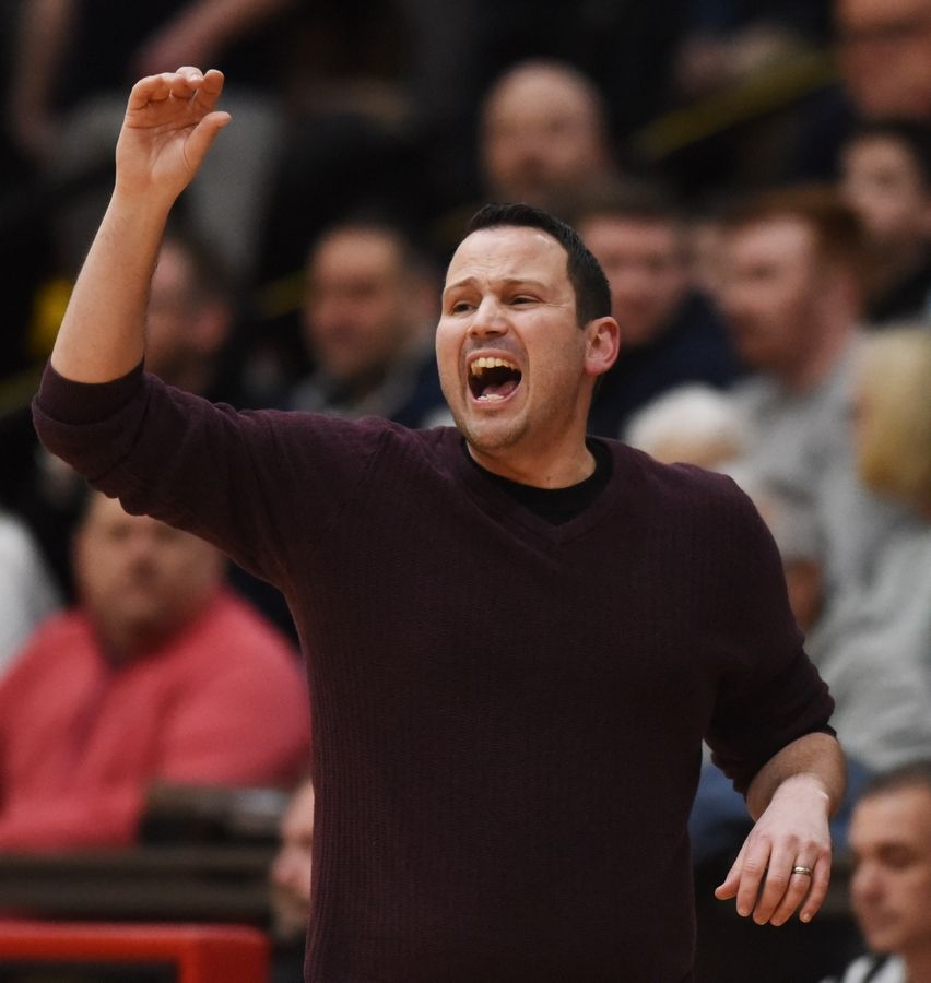 Schaumburg boys basketball coach Wade Heisler calls out instructions to his team during the Mid-Suburban League championship game against Buffalo Grove in Schaumburg Wednesday.