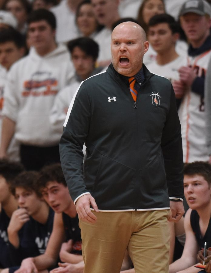 Buffalo Grove boys basketball coach Keith Peterson leads the Bison during the Mid-Suburban League championship game against Schaumburg Wednesday.