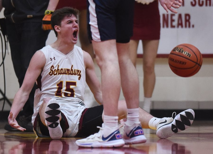 Schaumburg's Jared Schoo reacts after getting the basket and a foul during the Mid-Suburban League championship game against Buffalo Grove in Schaumburg Wednesday.
