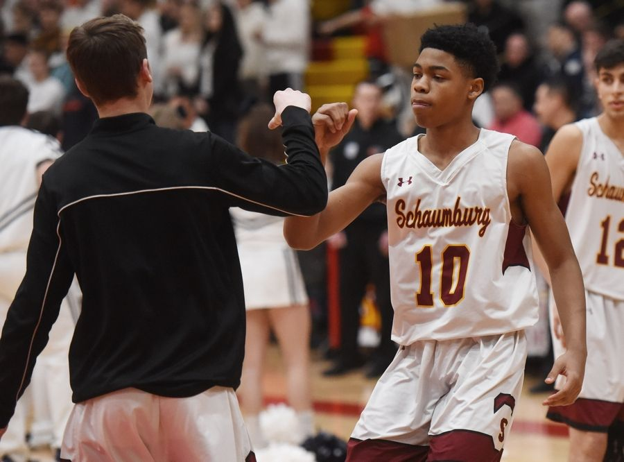 Schaumburg's Vaurice Patterson (10) is introduced prior to the start of the Mid-Suburban League championship game against Buffalo Grove in Schaumburg Wednesday.