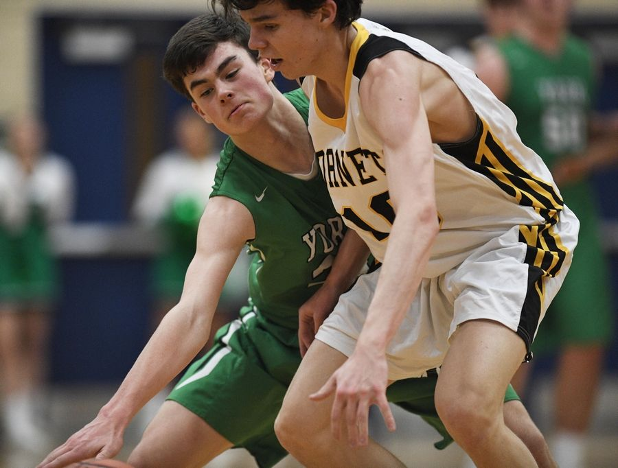 John Starks/jstarks@dailyherald.comYork's Drew Kircher taps the ball away from Hinsdale South's Billy Durkin in the West suburban Conference first-place crossover game at Addison Trail High School Wednesday.