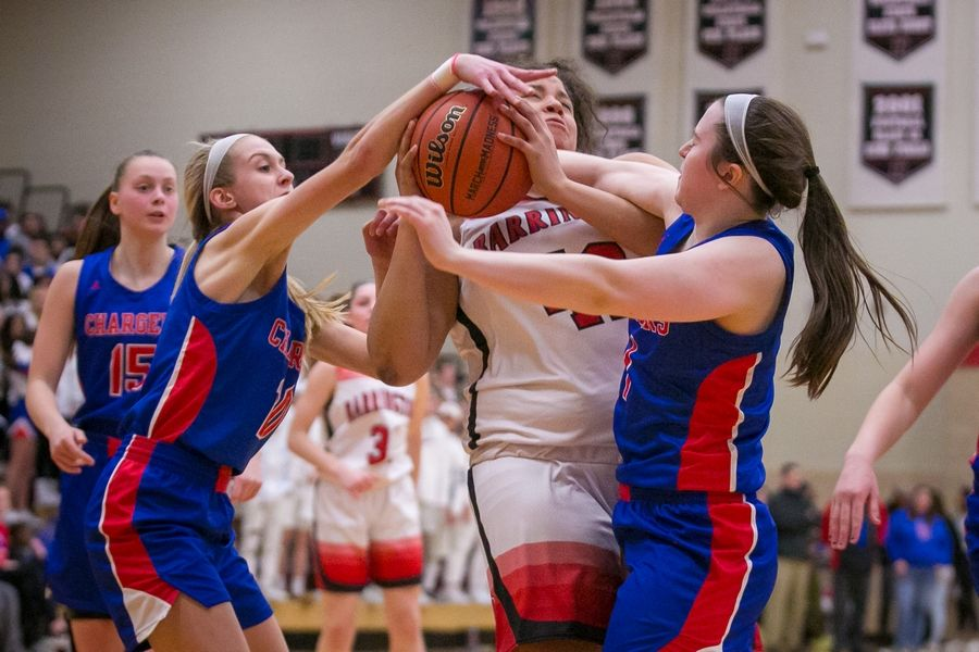 Dundee-Crown's Katelyn Skibinski(10) and Payton Schmidt (1) pressure Barrington's Taylor Thompson (42) in the third quarter of the IHSA Class 4A Huntley Sectional championship game at Huntley High School on Thursday, Feb. 27, 2020, in Huntley, Ill. Dundee-Crown won, 43-37.