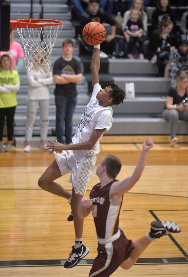 Kaneland guard Jamari Meeks scores on a fast break in the third quarter of the Knights' 66-44 Interstate 8 Conference win over Morris Friday in Maple Park.