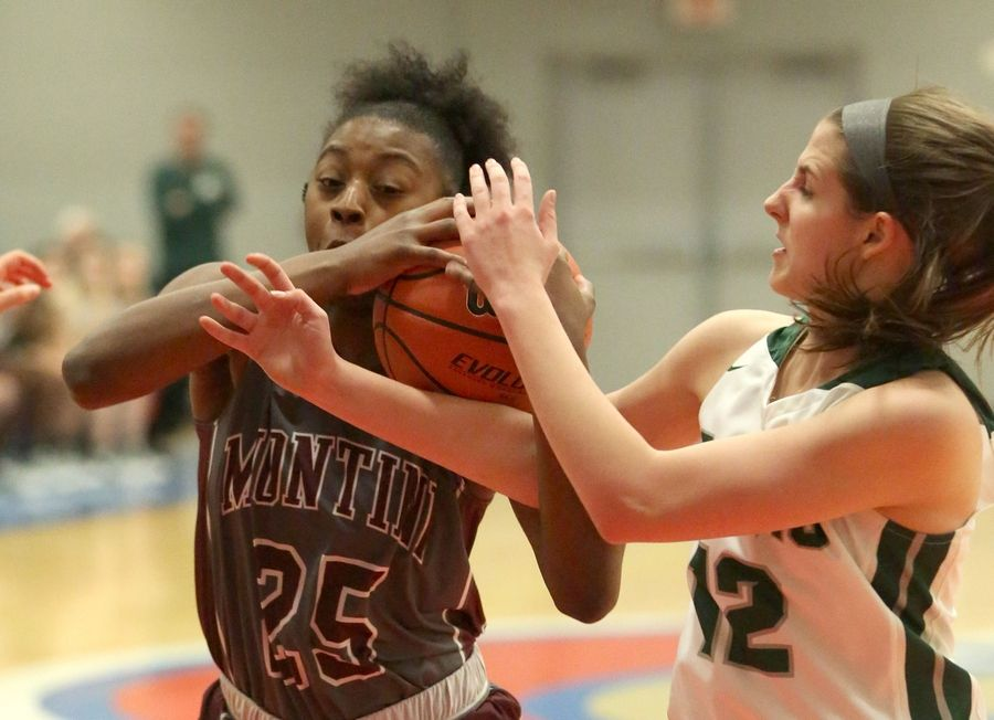 Grayslake Central's Amanda Kocialkowski, right, and  Montini's Taris Thornton, left, tussle for the ball in Class 3A girls basketball supersectional action at Elgin Community College Monday night.