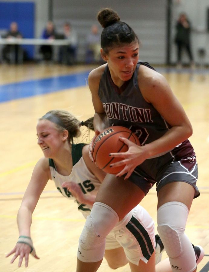 Montini's Tatiana Thomas moves with the ball under the net against Grayslake Central in Class 3A girls basketball supersectional action at Elgin Community College Monday night.