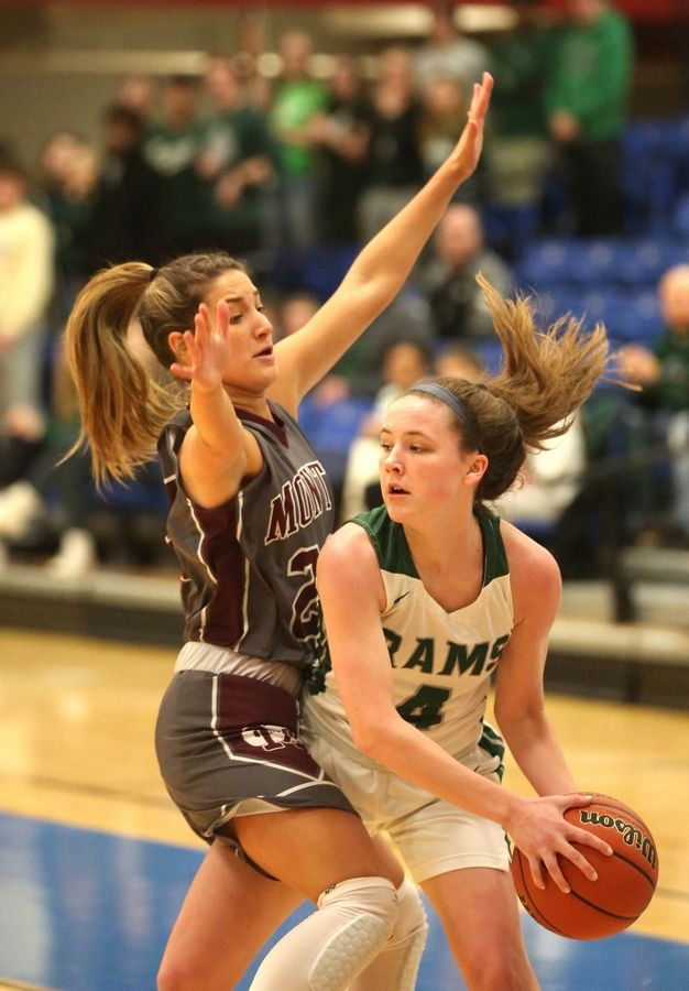 Grayslake Central's MK Drevline, right, looks past Montini's Angelina Giordano in Class 3A girls basketball supersectional action at Elgin Community College Monday night.