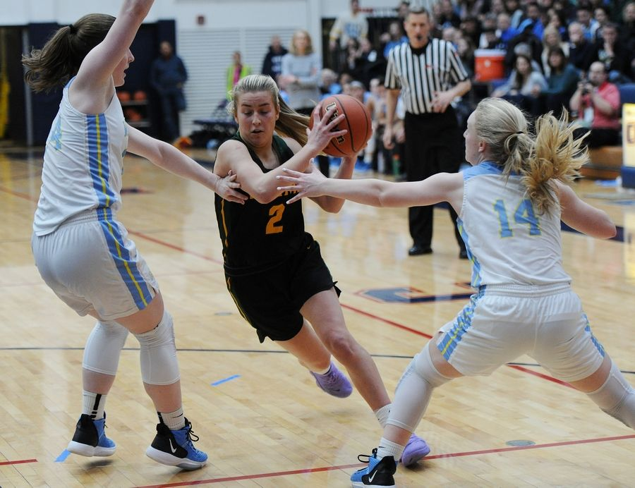 Fremd's Emily Klaczek works her way through Maine West's defense during Monday's Class 4A Conant supersectional. The Vikings take on Lake Park in Friday's state semifinals at Redbird Arena in Normal.