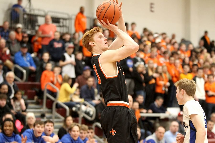 St. Charles East's Chase Monkemeyer attempts three points during the Elgin Regional Final against St. Charles North on March 6.