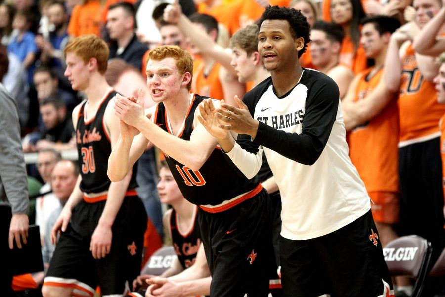 St. Charles East players try to rally their teammates in the final minutes of the Elgin Regional Final against St. Charles North on March 6.