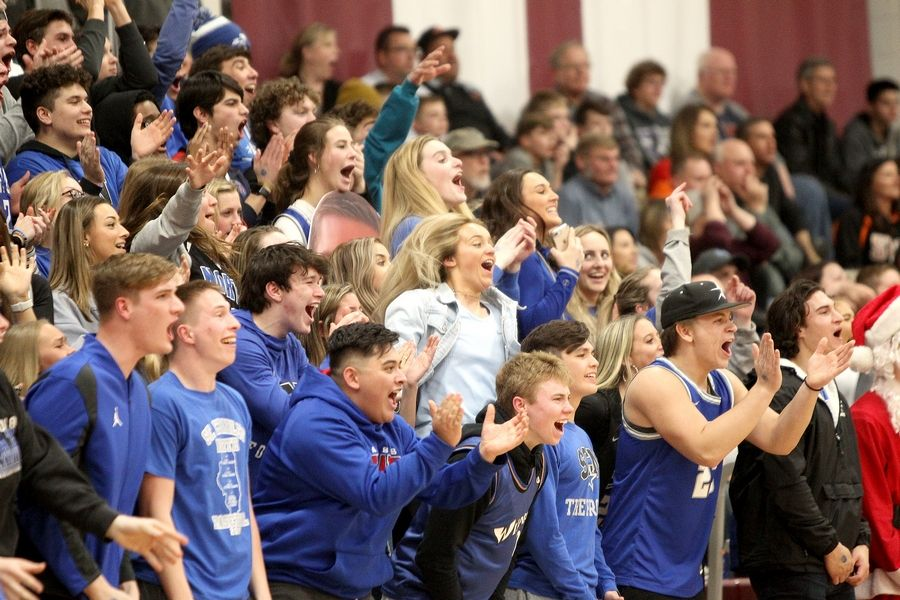 St. Charles North fans celebrate in the final minutes of North's Elgin Regional Final win over St. Charles East on March 6.