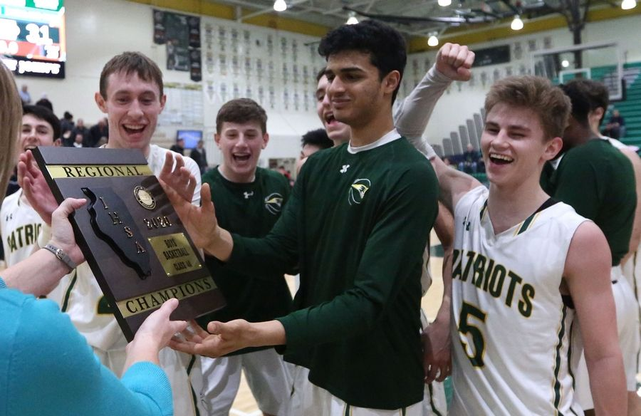 Stevenson's Patriots celebrate a win over Highland Park in Class 4A Stevenson regional final boys basketball action Friday night.