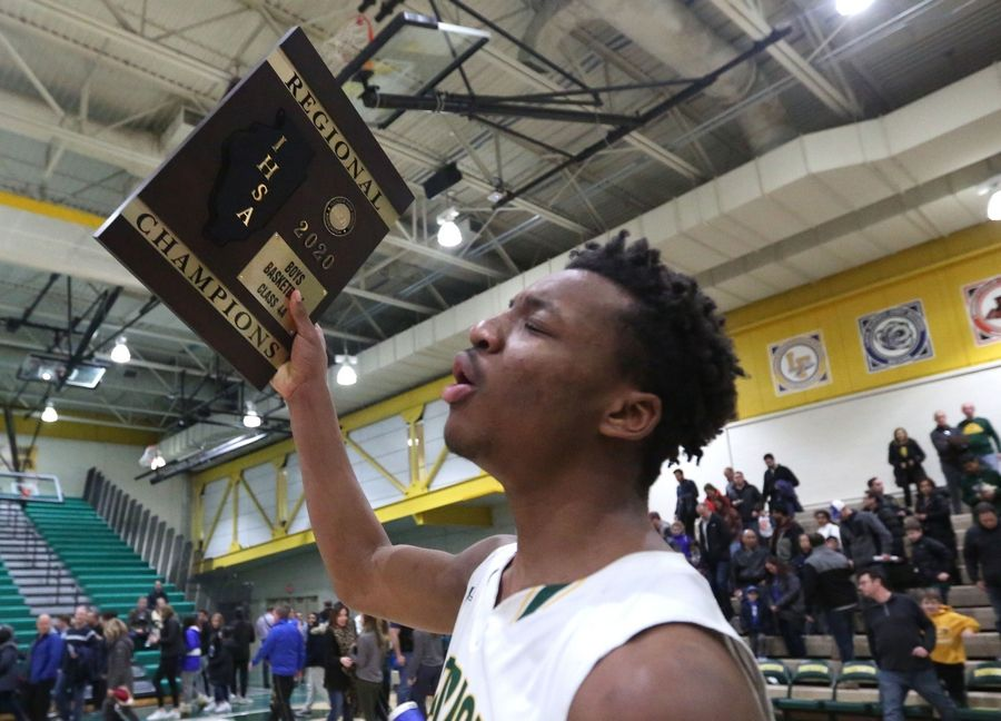 Robert Holmes and Stevenson's Patriots celebrate a win over Highland Park in Class 4A Stevenson regional final boys basketball action Friday night.