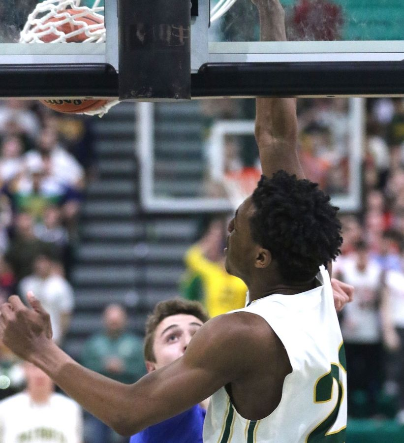 Stevenson's Robert Holmes slam dunks the ball against Highland Park in Class 4A Stevenson regional final boys basketball action Friday night.
