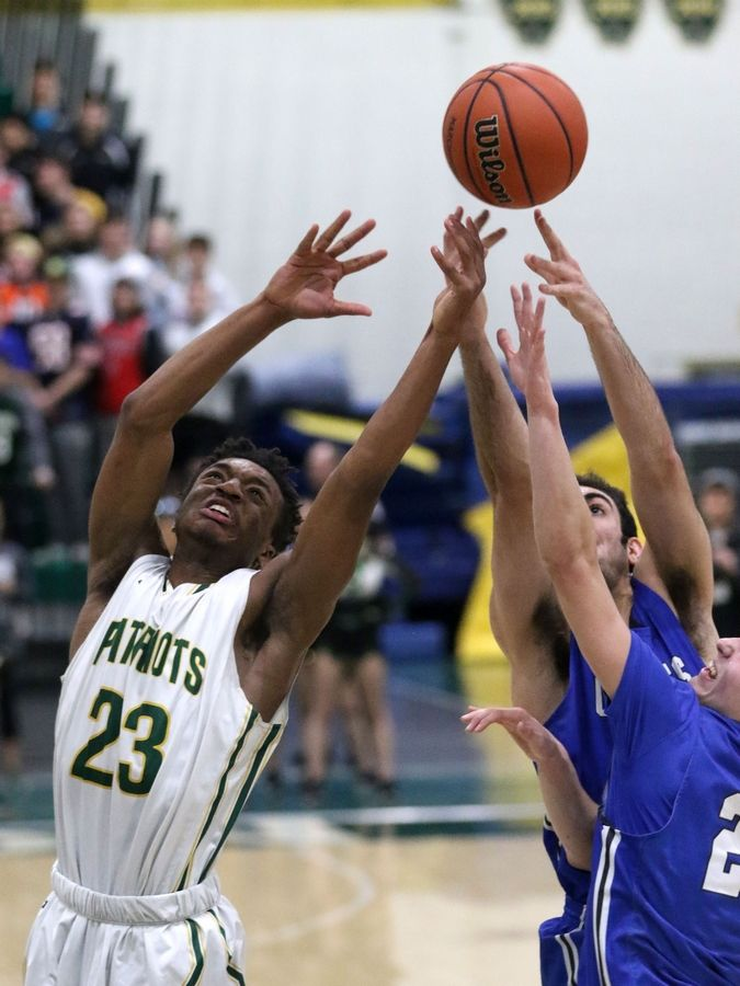 Stevenson's Robert Holmes scrambles for a rebound against Highland Park in Class 4A Stevenson regional final boys basketball action Friday night.