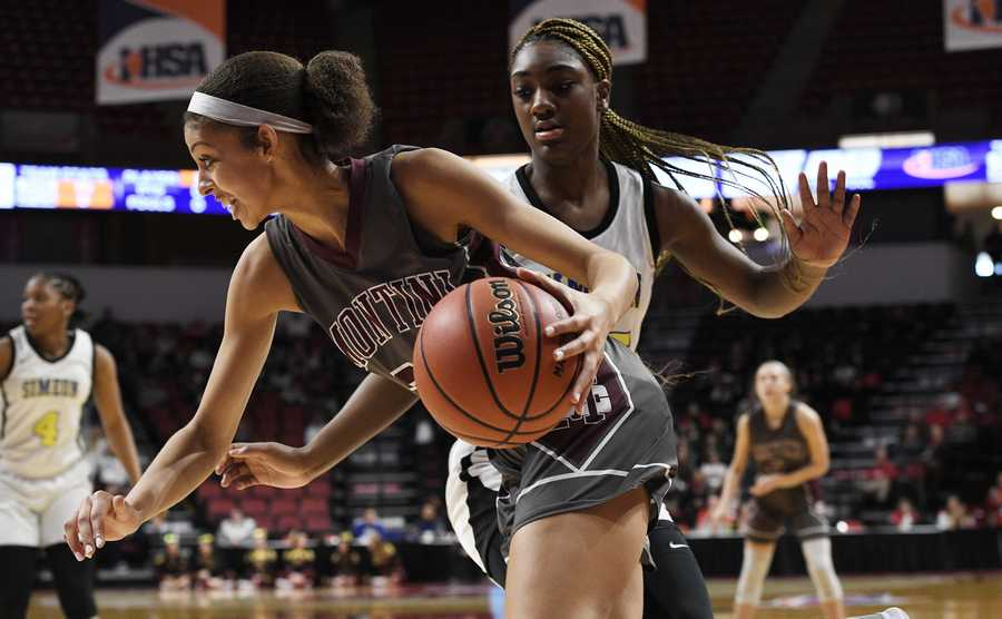 Montini's Taylor Charles is on the move past Simeon's Khaniah Gardner in the Class 3A state girls basketball semifinal in Normal on Friday.
