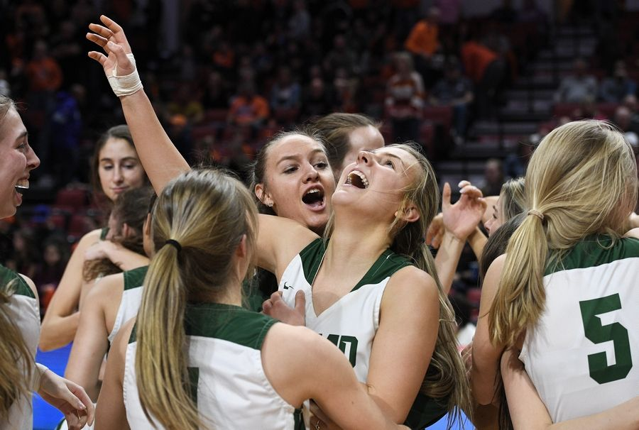 Fremd's Emily Klaczek is overcome with emotion as she and her teammates take the title beating Lincoln-Way West 58-47 in the 4A girls state basketball championship game in Normal on Saturday.
