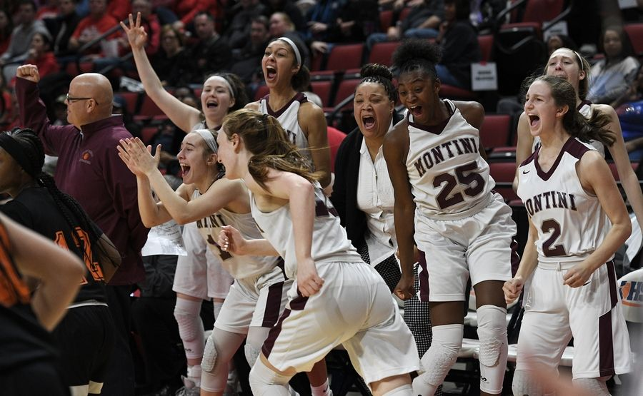 Montini's bench including Taris Thornton celebrate their third place win over Lanphier in the final seconds with the final score 55-43 in the Class 3A state girls basketball finals in Normal.