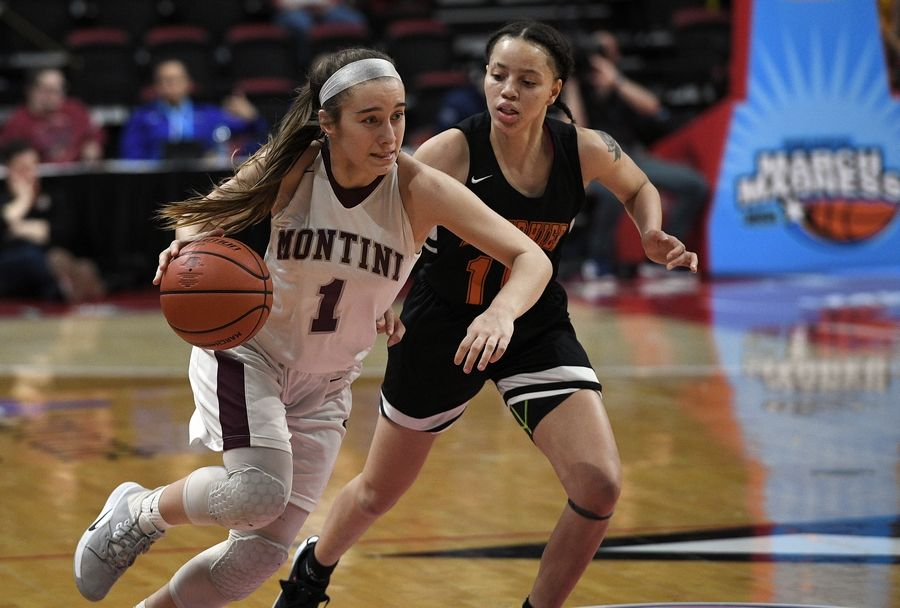 Montini's Sophie Sullivan on the move towards her fifteen point high in their third place win over Lanphier with the final score 55-43 in the Class 3A state girls basketball finals in Normal.