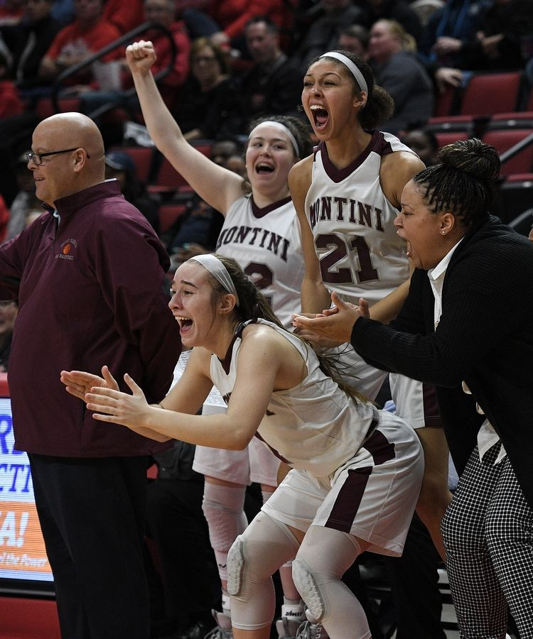 Montini's Taylor Charles and her teammates celebrate their third place win over Lanphier in the Class 3A state girls basketball finals in Normal.